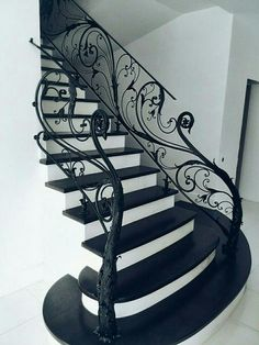 Beautiful black stairway. I can't tell if it's wood or metal, but I want this in my home!
