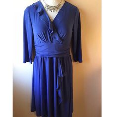 BOGOBeautiful periwinkle faux wrap dress Chadwicks faux wrap dress in periwinkle blue. Has a ruffled neckline on one side that follows down the dress to give the illusion of being a wrap dress with a waistband. Built-in slip provides coverage. Size is 10. Not interested in trades. Chadwicks Dresses