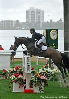 Kent Farrington & 'Blue Angel' win the 125,000 Trump Invitational Grand Prix. The Chronicle of the Horse