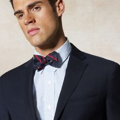 Great combination with the bow tie and the navy blazer.