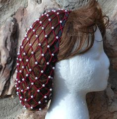 This snood is already made and is ready for shipment! These are photos of the snood you will receive. This is a snood hairnet made from #10 Burgundy crochet thread, heavily beaded with pearl beads. The beads are crocheted into the snood and will not come off unless the thread is cut.