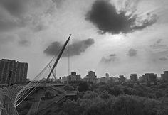 https://flic.kr/p/x4tUPc | Exponential Growth | Cherub shaped cloud retrieving it's spear from the Saetgang Bridge in Yeouido, Seoul.  www.mattmacdonaldphoto.com