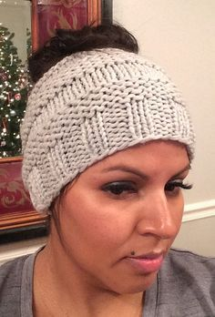 Free Knitting Pattern for Messy Bun Hat - This ponytail hat is a quick knit using about 90 yds of bulky weight yarn. Designed by Isela Phelps