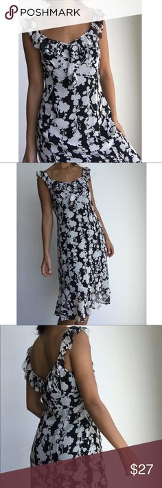 """ANN TAYLOR LOFT black white ruffles midi dress 6 Gorgeous floral black and white ruffled dress by Loft by Ann Taylor. Silk sheer and light weight makes it the perfect summer dress. Fully lined. Flounce ben and side zipper with top hook and eye. Empire waist 16"""" bust about 17 1/2"""" size 6. In excellent condition besides the little mark on the tag inside. LOFT Dresses Midi"""