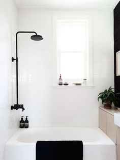 This is a trend that's been popping up a lot for the past year (at least) and when paired with a mostly white bathroom it has a distinctly Danish vibe.