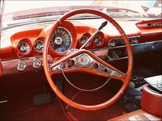 check out this vintage Impala! They had larger steering wheel because there was not power steering. Better leverage with a larger steering wheel.