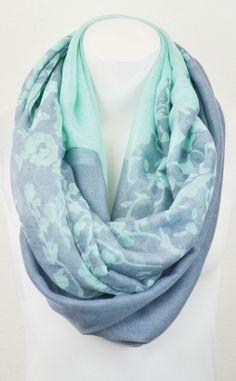 Mint & Blue Floral Infinity Scarf is popular and you can find it at www.shopsinglethread.com for a limited time!