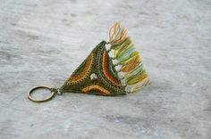 Folk and hippie woolen key chain. Key chain with embroidery and tassels. Olive green key chain. Eco friendly