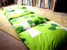DIY Pillow Bed: Fold a twin sheet in half long ways, then sew 4-5 sections the size of a pillow case, next insert pillows leaving ends open to remove pillows and wash. Or sew pillowcases together, or 3 yds fabric and 4 pillows