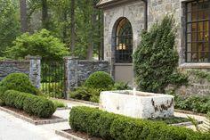 Antique horse trough fountain in garden by Howard Design Studio.