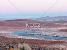 high angle shot of river and mountain range with clear sky in background. - High angle scenic shot of river and mountain range with clear sky in background.