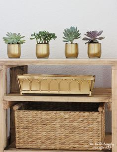 Formerly juice glasses, these petite planters are more proof that gold spray paint can make anything look luxe.