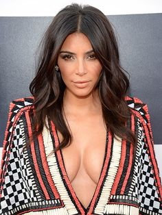 """Her lighter hair didn't last long this time, either. She was back to brunette the next month. """"Kim wanted to wear her hair down, and I wanted to keep it easy,"""" says McMillan of this cool-girl style."""