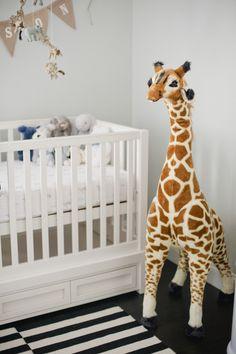 Neutral nursery with oversize giraffe