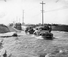 """Photograph caption dated March 6, 1954 reads --- """"Not too long ago this is the way motorists and pedestrians were forced to negotiate Pacoima Wash at Laurel Canyon Boulevard during storms. Then Valley progress stepped forward."""""""