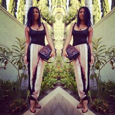 Jeannie Mai carrying Monika Chiang Ponyhair Bulleit Clutch