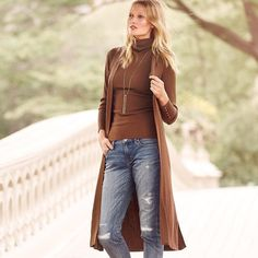 """Weekend warriors can now rejoice. We have your perfect ensemble and it all begins with this finely ribbed sweater, infused with luxurious wool. Our current outfit inspiration is wearing this longline piece with a turtleneck shell, distressed jeans and sky-high suede boots. Sweater duster Polyester/wool. Hand wash, cold. Regular: Approx. 48.5"""" from shoulder Petite: Approx. 47"""" from shoulder Imported Complement your Fall wardrobe of rich suede and buttery leather looks with this snake-embossed…"""