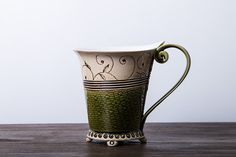 Teacup or coffee cup with greendecoration handmade pottery with glazed cover.    This is the perfect cup for your morning hot coffe or tea.