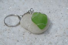 Genuine frosted green sea glass keychain. Genuine hand wire wrapped frosted sea glass and silver chain key ring for keys. The sea glass is real