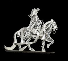 chalan de plata en filigrana - I believe that this is done in silver wire filagree, but it could also be replicated in paper Quilling