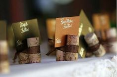 Place cards. http://9bytz.com/wine-cork-crafts/