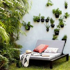 Outdoor Patio Inspiration :: TEC chaise lounge chair with cushion vertical wall plants and succulents lush backyard vibes desert