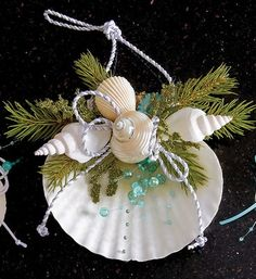 Coastal Holiday Decor Such a pretty addition to your coastal holiday celebration! Nautical Christmas, Beach Christmas, Noel Christmas, Purple Christmas, Seashell Projects, Seashell Crafts, Beach Crafts, Driftwood Crafts, Beach Ornaments
