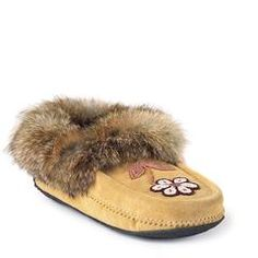 If we had to pick our most iconic family of products, the Metis might just be it. From the careful construction and suede-and-fur exterior to the signature beadwork, our Metis moccasins and mukluks are steeped in tradition. All Fashion, Fashion Brands, Canadian Winter, Global Brands, Fur Trim, Traditional Art, Dress Me Up, Moccasins, Beadwork