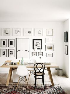 Black and white gallery wall in workspace