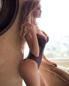 Blonde girl near window