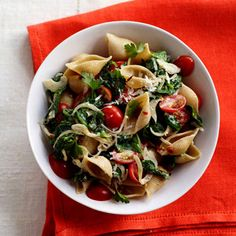 Spinach-Tomato Pasta Shells - Get your greens—plus a heaping 9 grams of fiber—with this yummy pasta dish created by Guy Fieri. http://www.health.com/health/gallery/0,,20399696_3,00.html