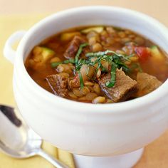 Italian Beef and Lentil Slow-Cooker Stew Recipe Soups, Main Dishes with onions, garlic cloves, zucchini, beef round, dried oregano, diced tomatoes, tomato paste, dried lentils, canned beef broth, table salt, black pepper, basil