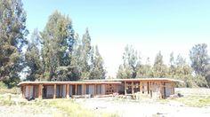 Casa de vigas de madera