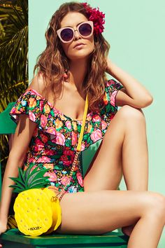 Floozie by FrostFrench floral print swimsuit. Add a playful twist to your shoreline style with vibrant prints, look-at-me ruffles and off the shoulder bardot one pieces. Available now at Debenhams.