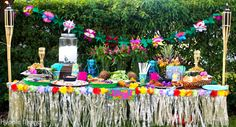 Luau Party Tablescape - Everything from tiki torches to grass skirts. All the essentials for your luau.