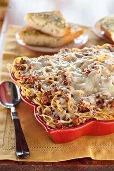 The Deen Bros Mama's Spaghetti Casserole with Baked Garlic Herb Bread (the garlic bread alone is worth pinning...PERFECT garlic bread!)