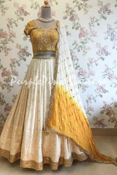 Ivory and Mustard Yellow Lucknowi Lehenga Choli - Lehenga Choli are the most preferred Indian Ethnic Wear for Woman. This Ivory and Mustard Yellow Lucknowi Lehenga Choli can uplift your style. Indian Bridal Outfits, Indian Designer Outfits, Indian Dresses, Designer Dresses, Indian Clothes, Mehendi Outfits, Desi Clothes, Wedding Outfits, Designer Wear