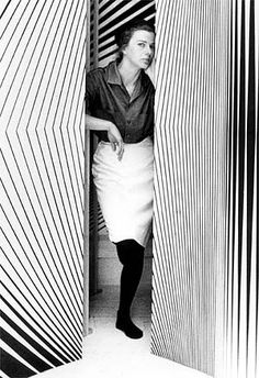 Bridget Riley with some of her paintings. Op Art became mainstream with the 1965 exhibition The Responsive Eye at the MoMA.
