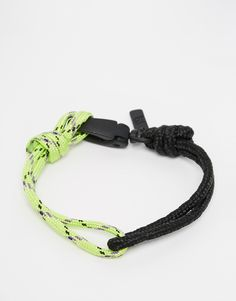 Bracelet by ICON BRAND Two-tone, cord bracelet Branded tag detail Lobster clasp fastening 60% Cord, 40% Zinc Alloy
