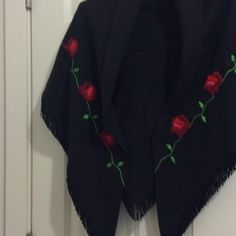 "Shawl Black with embroidery Red roses Shawl has hand embroidery red roses with green leaves, 1 inch Fringe. All in cotton double fabric no seams. Absolutely beautiful for the cold winter nights and evenings on the patio. Or a dinner date? TRIANGLE 66"" x 44"" x 44"".  A stunning shawl with a beautiful simple design. Jackets & Coats Capes"