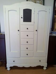 A little chalkboard and black knobs go a long way