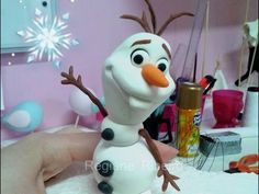 In this disney Frozen cake tutorial I show you how to make a fondant / modelling paste Anna cake topper to use on your frozen themes cakes. Modelling paste m...