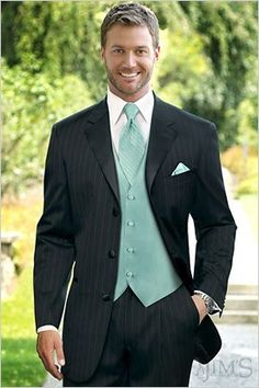 black tux with vest &(red tie and red rose infront of lapel?) ours would be light blue maybe