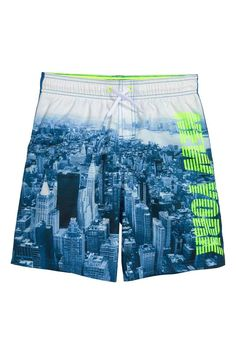 3bec0efa3f Printed swim shorts: Swim shorts with a print on the front and solid colour…