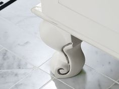Curvy feet give this bath vanity the look of a vintage furniture piece.