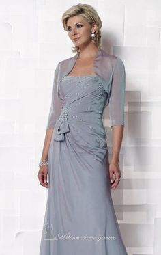 Mother of the Bride / Wedding guest -Look impressive with this strapless Cameron Blake 112647! This iridescent chiffon evening gown looks more special with its gathered side skirt detail. It comes with a matching lovely bolero and it is finely embellished. These accents include fabric accent and shimmering beads that are perfectly located on its ruched fitted bodice. This gown also features a straight neckline, natural waistline and an A-line floor-length skirt.