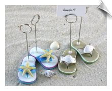 The preferred beach wear is the flip flop so why not feature them at your beach wedding. These darling, hand painted flip flop place card holders will splash a little summery color on your reception tables.