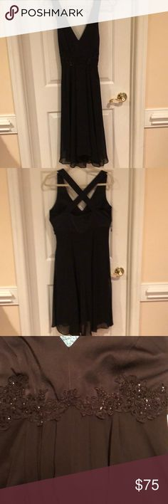 Little Black Dress Little black dress in a size 10 by Donna Morgan. Worn once to a captains dinner. Cross crossed back with satin top and sheer black overlay at the bottom. The waist is accented by a floral design with sequins to add just enough pop. Donna Morgan Dresses Midi