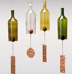 Wind chimes made with bottles. I like the idea for lamps.