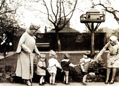 Queen Mary (L) with some of the children from the nursery school attached to the Rachel McMillan Training College in Deptford, London - 1 May 1930